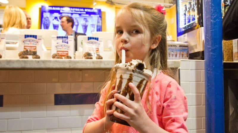Bailey Stites, 5, tries the Tastykake and Bassetts Ice Cream collaboration milkshake. (Kimberly Paynter/WHYY)
