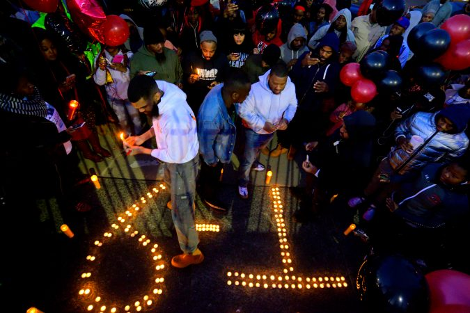 Hundreds of fans, friends and family mourn at a vigil for battle rapper Akeem Mickens (professionally known as Tech9) at the Happy Hollow playground, in the Germantown section of Philadelphia on Tuesday Jan 26, 2019. (Bastiaan Slabbers for WHYY)