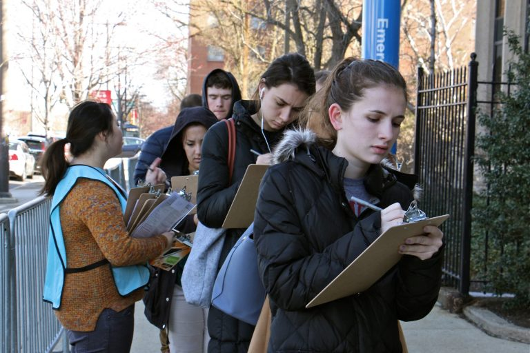 Students and faculty at Temple University line up outside Mitten Hall for free mumps vaccinations. The university scheduled two vaccination clinics after a mumps outbreak sickened more than 100. (Emma Lee/WHYY)