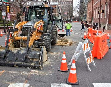 Philadelphia Water Department workers excavate at the intersection of 5th and Chestnut. (Emma Lee/WHYY)