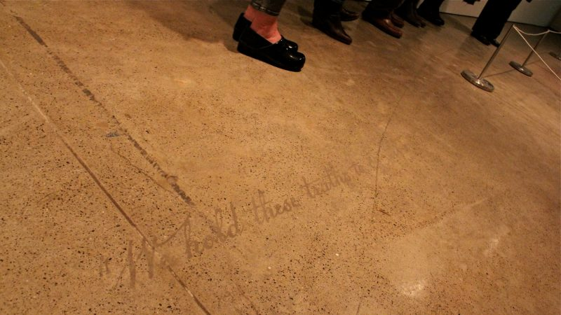 Words from the Declaration of Independence emerge from the dirty floor. In a public performance that will open the exhibit, artist Sonya Clark will clean the floor using a dishcloth commercially printed with the Confederate battle flag, revealing the text. (Emma Lee/WHYY)