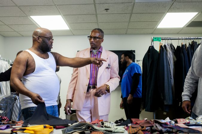 George Stevenson, a member of Enon Tabernacle, helps men pick out suits and offers advice on style. (Brad Larrison for WHYY)