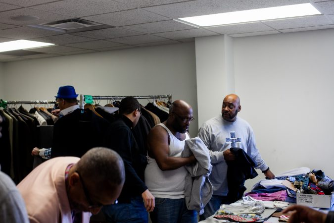 Suits and other clothing were given out to men at the Enon Tabernacle Baptist Church during the 2019 Men's Health Iniative Saturday. (Brad Larrison for WHYY)