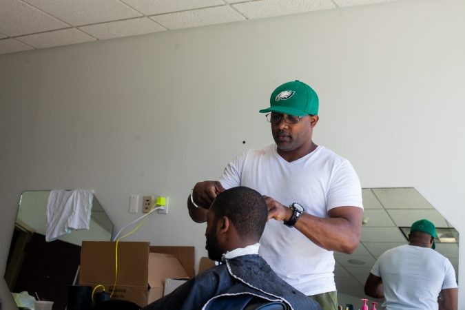 Darian McFadden, a local barber, provided haircuts to men at the 2019 Men's Health Iniative at Enon Tabernacle Baptist Church Saturday. (Brad Larrison for WHYY)