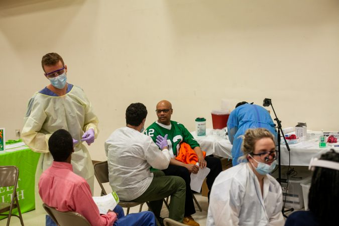 Temple University's School of Dentistry provides oral checkups to men at the 2019 Men's Health Initiative at Enon Tabernacle Baptist Church Saturday. (Brad Larrison for WHYY)