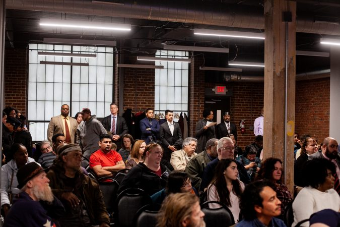 Residents of Kensington and city officials attend a meeting to provide updates on the Philadelphia Resilience Projects's efforts to combat the opioid epidemic. (Brad Larrison for WHYY)