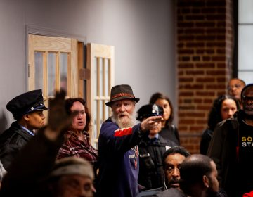 A man is angered by the discussion of a proposed safe injection site, yelling as he leaves a meeting Tuesday evening that provided updates on the Philadelphia Resilience Project's efforts to combat the oipiod crisis. (Brad Larrison for WHYY)