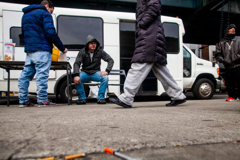 Louis Morano, who was visiting the Prevention Point bus for the second time, sits outside and waits to be seen by Dr. Ben Cocchiaro. (Brad Larrison for WHYY)
