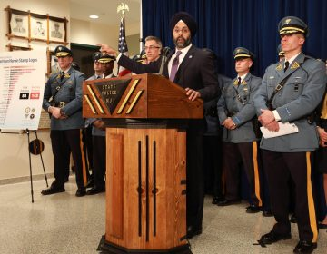 Attorney General Gurbir Grewal, New Jersey State Police Captain Gregory Demeter and U.S. Homeland Security Investigations Assistant Special Agent in Charge Brett Dreyer announce the arrests of three men in the takedown of a major fentanyl and heroin mill, in Harrison, N.J., that distributed its narcotics in wax folds stamped with the same brand names that have been linked to 227 overdoses, including 84 deaths, in Newark, N.J. on Thursday, March 21, 2019. (Tim Larsen/Office of the Attorney General)