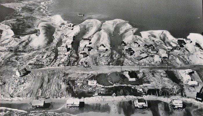 An Army Corps of Engineers aerial photograph shows the devastation from the March storm of 1962 in Harvey Cedars. The storm opened up a new inlet to Barnegat Bay near 79th street. The Army Corps of Engineers listed closing the inlet as a priority project in the expansive repairs the corps made along the Mid-Atlantic coast following the storm. (Courtesy of the Army Corps of Engineers)