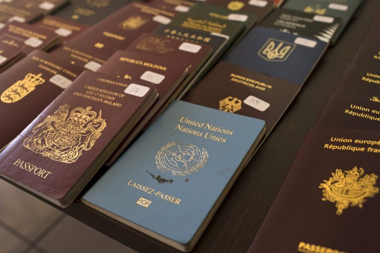 In this Wednesday, Feb. 28, 2018 file photo, authorities present confiscated passports and identification cards (Petros Giannakouris/AP Photo)