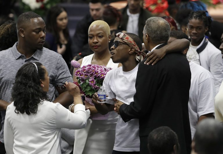 Stevante Clark, (center right), hugs family and mourners during the funeral services for police shooting victim Stephon Clark at Bayside Of South Sacramento Church in Sacramento, Calif., Thursday, March 29, 2018. Clark, who was unarmed, was shot and killed by Sacramento Police Officers, Sunday, March 18, 2018. (Jeff Chiu/AP Photo, Pool)