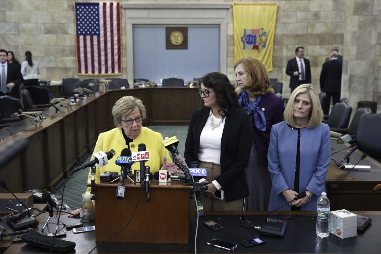 New Jersey state Senate Majority Leader Loretta Weinberg, left, D-Teaneck, stands with Assemblywoman Eliana Pintor Marin, second from left , D-Newark, N.J., state Sen. Nancy F. Munoz, second from right, R-Summit, N.J., and Kristin M. Corrado, R-Totowa, N.J., as they address a gathering after Katie Brennan, not seen, the chief of staff at the New Jersey Housing and Mortgage Finance Agency, testified before the Select Oversight Committee at the Statehouse, Tuesday, Dec. 4, 2018, in Trenton, N.J. Brennan, a top staffer at the state's housing agency who came forward as a sexual assault victim, and has said too little was done about her complaints, which she reported to law enforcement. (AP Photo/Mel Evans)