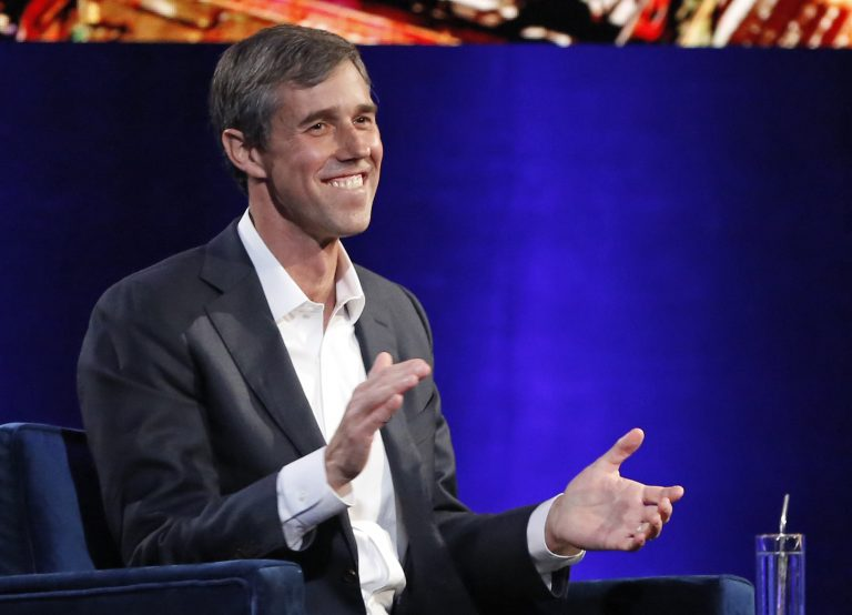 Former Democratic Texas congressman Beto O'Rourke laughs as with Oprah Winfrey presses him to make the announcement that he is running for president during a live interview on a Times Square stage at