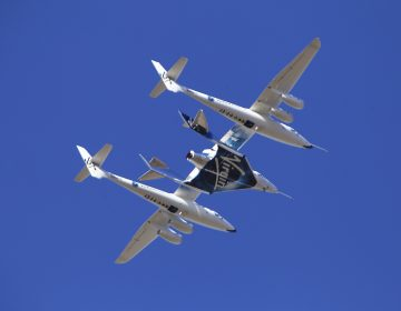 Virgin Galactic's VSS Unity rocket plane flown into the atmosphere before launching Friday, Feb. 22, 2019, in  Mojave, Calif. Virgin Galactic says its rocket plane has reached space for a second time in a test flight over California on Friday. In addition to two pilots, the spacecraft carried a third crewmember to evaluate the cabin from a passenger perspective. (AP Photo/Matt Hartman)