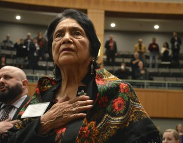 Dolores Huerta, 88, the Mexican-American social activist who formed a farmworkers union with Cesar Chavez, stands for the Pledge of Allegiance in Spanish while visiting the New Mexico Statehouse on Wednesday, Feb. 27, 2019. The New Mexico-born Huerta was honored by the House for
