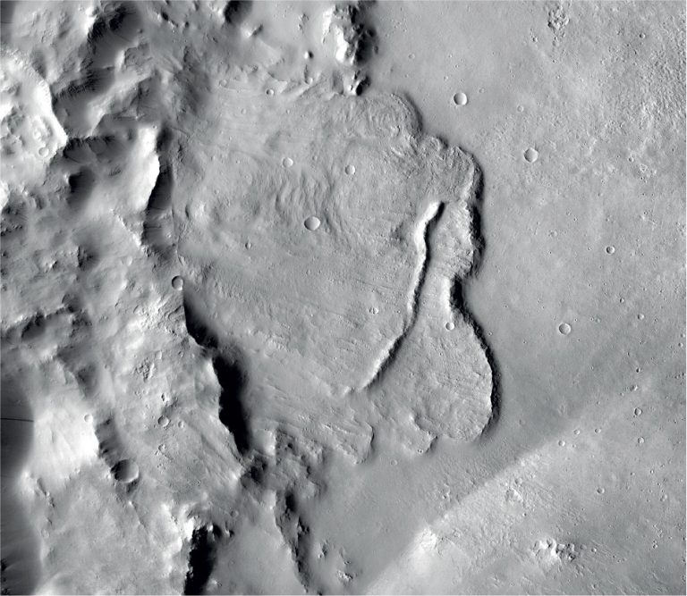 This undated photo provided by the European Space Agency, ESA, shows the surface of the Mars. Scientists say images of Martian craters taken by European and American space probes show there likely once was a planet-wide system of underground lakes. (NASA/JPL-Caltech/MSSS via AP)