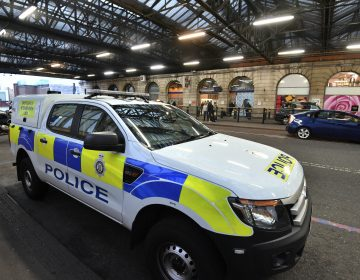 A British Transport Police vehicle is seen at Waterloo Railway Station, after three small improvised explosive devices were found at buildings at Heathrow Airport, London City Airport and Waterloo in London, Tuesday, March 5, 2019. (John Stillwell/PA via AP)
