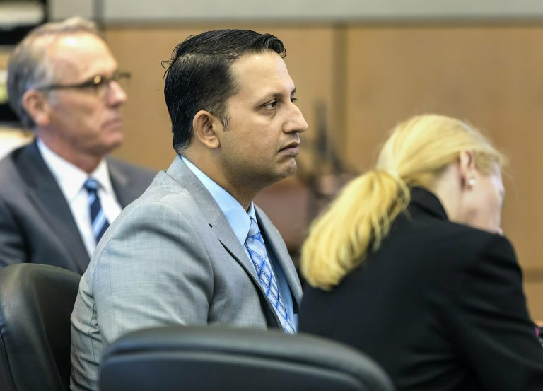 Nouman Raja sits between defense attorney Scott Richardson, (left), and paralegal Debi Stratton as attorney Richard Lubin gives his closing arguments in Raja's trial, Wednesday, March 6, 2019 in West Palm Beach, Fla. (Lannis Waters/Palm Beach Post via AP, Pool)