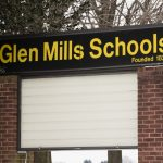 A sign stands outside the Glen Mills Schools in Glen Mills, Pa., Thursday, March 7, 2019. Pennsylvania Gov. Tom Wolf has ordered a review of abuse complaints against a suburban Philadelphia reform school. Lawmakers and children's advocates on Wednesday called for the state to launch an investigation into allegations of child abuse and cover-ups at the schools. (AP Photo/Matt Rourke)