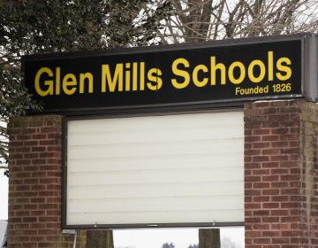 A sign stands outside the Glen Mills Schools in Glen Mills, Pa.