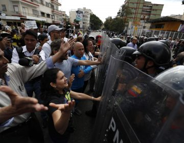 Venezuelan police block a crowd of people who gather to march against the government of President Nicolas Maduro, in Caracas, Venezuela, Saturday, March 9, 2019. Security forces are deploying in large numbers in Caracas ahead of the planned demonstrations by supporters of opposition leader Juan Guaido. (Eduardo Verdugo/AP Photo)