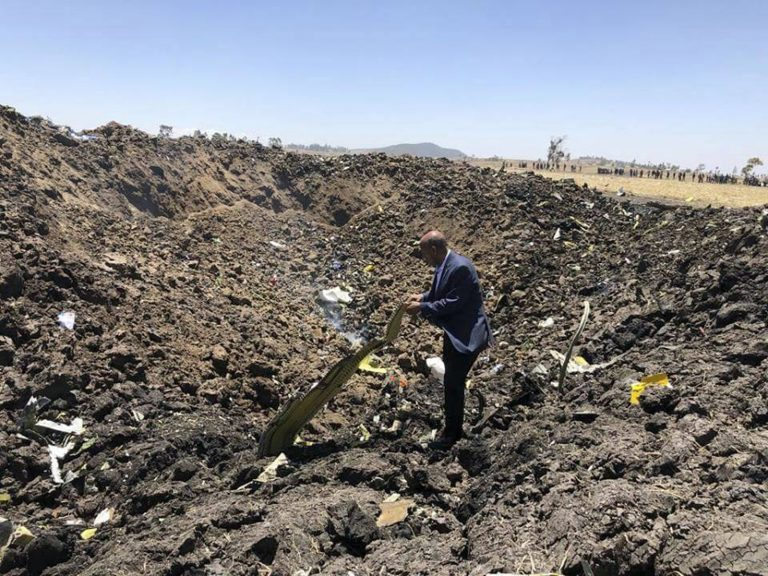 In this photo taken from the Ethiopian Airlines Facebook page, the CEO of Ethiopian Airlines, Tewolde Gebremariam, looks at the wreckage of the plane that crashed shortly after takeoff from Addis Ababa, Ethiopia, Sunday March 10, 2019. An Ethiopian Airlines flight crashed shortly after takeoff from Ethiopia's capital on Sunday morning, killing all 157 people thought to be on board, the airline and state broadcaster said, as anxious families rushed to airports in Addis Ababa and the destination, Nairobi. (Facebook via AP)