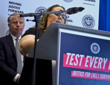Manhattan District Attorney Cyrus Vance, (left), listens while sexual assault survivor Tracy Rios speaks about her attack, during a press conference, Tuesday March 12, 2019, in New York. Vance released results of a $38 million national initiative to help law enforcement agencies perform DNA tests on evidence in thousands of languishing rape cases. (Bebeto Matthews/AP Photo)