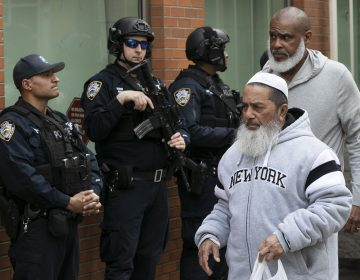 Men leave the Islamic Cultural Center of New York under increased police security following the shooting in New Zealand, Friday, March 15, 2019, in New York. (Mark Lennihan/AP Photo)