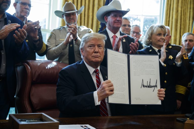 President Donald Trump signs the first veto of his presidency in the Oval Office of the White House, Friday, March 15, 2019, in Washington. (Evan Vucci/AP Photo)