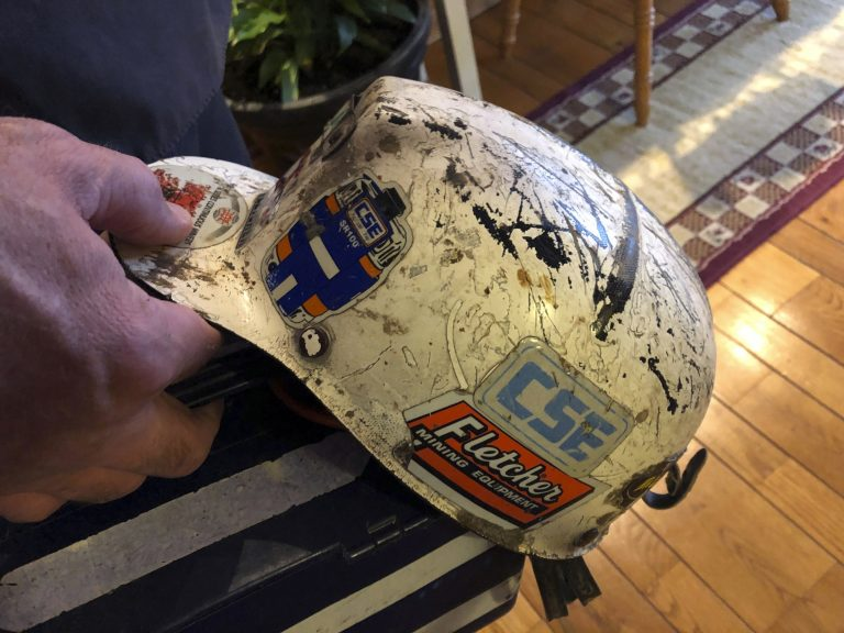 Retired coal miner John Robinson displays his mining helmet at his home in Coeburn, Va., on Thursday, Jan. 24, 2019. Robinson was 47 when he was diagnosed with black lung disease, part of a new generation of black lung sufferers who are contracting the deadly disease at younger ages. (Dylan Lovan/AP Photo)