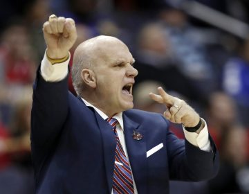 In this March 10, 2018, file photo Saint Joseph's head coach Phil Martelli directs his team during the first half of an NCAA college basketball semifinal game against Rhode Island in the Atlantic 10 Conference tournament in Washington. Saint Joseph's fired Martelli on Tuesday, March 19, 2019, after 24 seasons. The 64-year-old Martelli became head coach in 1995 after 10 years as an assistant.  (Alex Brandon/AP Photo, File)