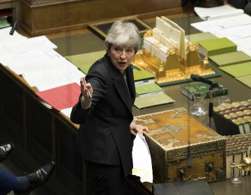 In this handout photo made available by UK Parliament, Britain's Prime Minister Theresa May speaks during Prime Minister's Questions in the House of Commons, London, Wednesday March 20, 2019. Exactly 1,000 days after Britain voted to leave the European Union, and nine days before it is scheduled to walk out the door, Prime Minister Theresa May hit the pause button Wednesday, asking the bloc to postpone the U.K.'s departure until June 30. (UK Parliament/Mark Duffyvia AP)