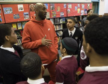 Former Los Angeles Lakers NBA basketball player Kobe Bryant meets with students at Andrew Hamilton School in Philadelphia, Thursday, March 21, 2019. Kobe Bryant was promoting the book The Wizenard Series: Training Camp he created with writer Wesley King. (AP Photo/Matt Rourke)