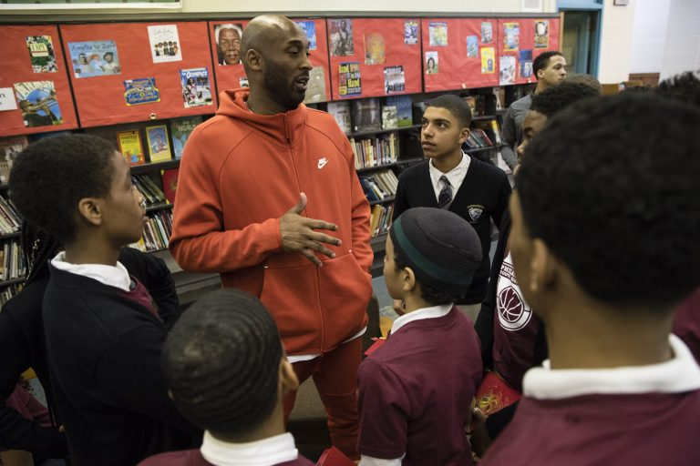 90081c75458 Former Los Angeles Lakers NBA basketball player Kobe Bryant meets with  students at Andrew Hamilton School