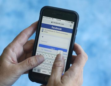 In this Aug. 21, 2018, file photo a Facebook start page is shown on a smartphone in Surfside, Fla. Facebook said Thursday, March 21, 2019, that it stored millions of its users' passwords in plain text for years. The acknowledgement from the social media giant came after a security researcher posted about the issue online. (Wilfredo Lee/AP Photo, File)
