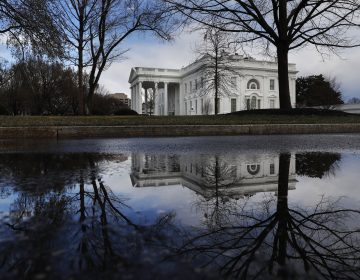 The White House is reflected in a puddle, Friday March 22, 2019, in Washington, as news breaks that the special counsel Robert Mueller has concluded his investigation into Russian election interference and possible coordination with associates of President Donald Trump. (Jacquelyn Martin/AP Photo)