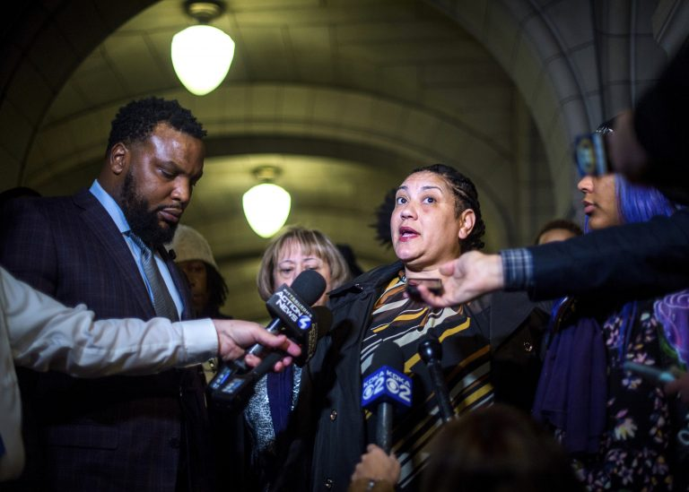 Rose family attorney, S. Lee Merritt, (left), and Michelle Kenney, (center), mother of Antwon Rose II, address members of the media following the closing arguments in the homicide trial of former East Pittsburgh Police officer Michael Rosfeld, Friday, March 22, 2019, at the Allegheny County Courthouse in Pittsburgh. (Nate Smallwood/Pittsburgh Tribune-Review via AP, Pool)