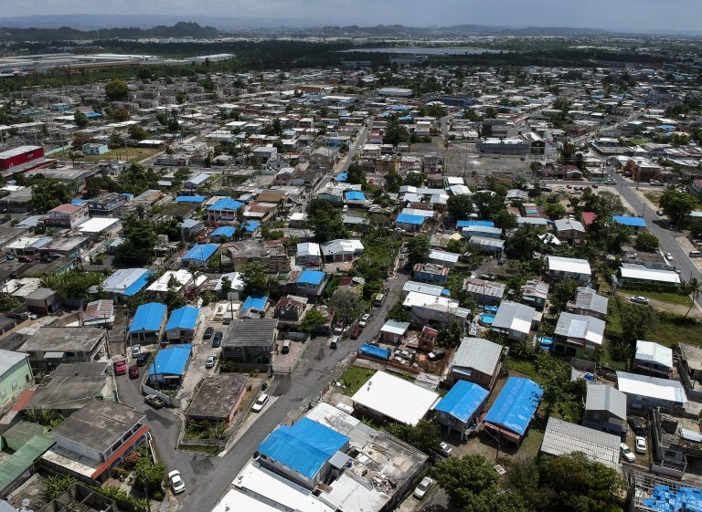 This June 18, 2018, file photo shows an aerial view of the Amelia neighborhood in the municipality of Catano, east of San Juan, Puerto Rico. (Dennis M. Rivera/AP Photo)