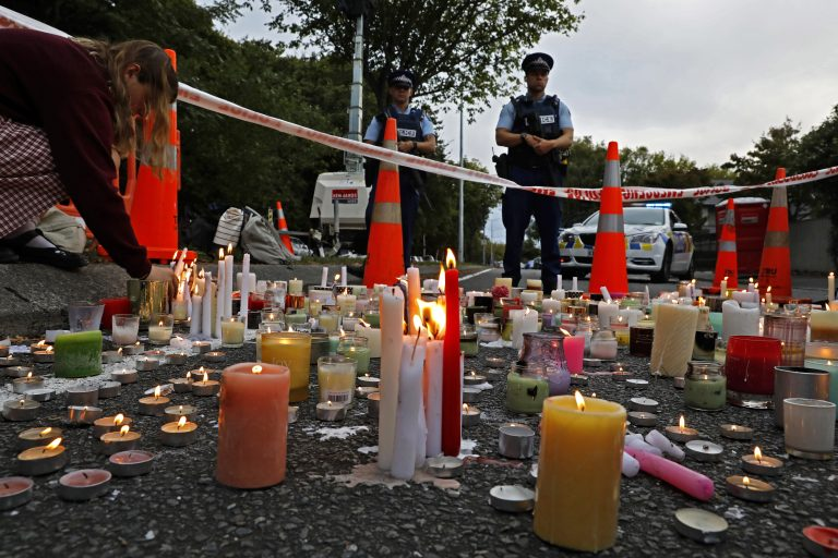 In this March 18, 2019, file photo, a student lights candle during a vigil to commemorate victims of March 15 shooting, outside the Al Noor mosque in Christchurch, New Zealand. New Zealanders are debating the limits of free speech after their chief censor banned a 74-page manifesto written by a man accused of massacring 50 people at two mosques. (Vincent Yu/AP Photo)