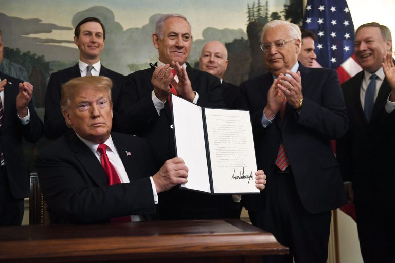 President Donald Trump holds up a signed proclamation recognizing Israel's sovereignty over the Golan Heights, as Israeli Prime Minister Benjamin Netanyahu looks on in the Diplomatic Reception Room of the White House in Washington, Monday, March 25, 2019. (Susan Walsh/AP Photo)