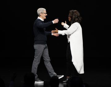 Apple CEO Tim Cook and Oprah Winfrey prepare to embrace at the Steve Jobs Theater during an event to announce new products Monday, March 25, 2019, in Cupertino, Calif. (Tony Avelar/AP Photo)