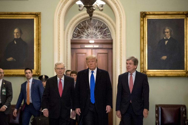 President Donald Trump accompanied by Senate Majority Leader Mitch McConnell of Ky., left, and Sen. Roy Blunt, R-Mo., right, arrives for a Senate Republican policy lunch on Capitol Hill in Washington, Tuesday, March 26, 2019. (Andrew Harnik/AP Photo)
