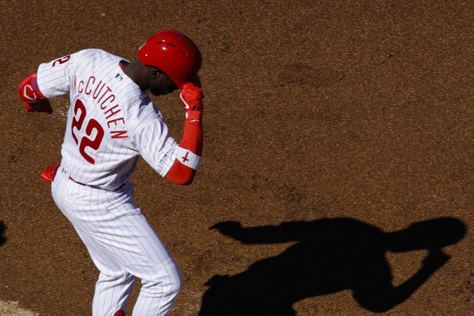 Philadelphia Phillies' Andrew McCutchen tips his helmet as he heads to home base after hitting a home run off Atlanta Braves starting pitcher Julio Teheran, right, during the first inning of an opening day baseball game, Thursday, March 28, 2019, in Philadelphia. (AP Photo/Matt Rourke)