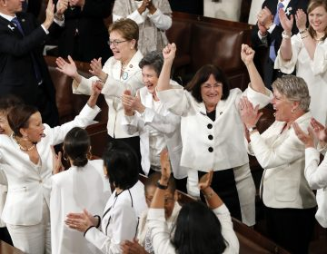 In this Feb. 5, 2019 file photo, women members of Congress cheer after President Donald Trump acknowledges more women in Congress during his State of the Union address to a joint session of Congress on Capitol Hill in Washington. A new survey finds acceptance of women in American politics and the workforce is at a record high. (J. Scott Applewhite/AP Photo)