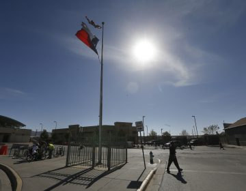 A person crosses the street at a U.S Mexico border crossing in El Paso, Texas, Friday, March 29, 2019. (Gerald Herbert/AP Photo)