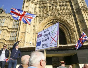Protesters are seen with placards and Union Jack flags in front of Victoria Tower during the demonstration. Leave campaigners protest against the delay to Brexit, on the day that UK was due to leave the European Union. British Prime Minister Theresa May's Brexit deal was defeated for a third time by a margin of 58 votes. (Photo by Dinendra Haria/SOPA Images/Sipa USA via AP Images)