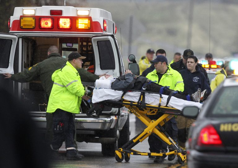 Emergency personnel load a patient into an ambulance on Dec. 4, 2012, after two people were shot and a third detained after California Highway Patrol officers shot at a red pickup truck during a chase that ended at Happy Valley road near Gas Point Road in Cottonwood, Calif. (AP Photo/Record Searchlight, Andreas Fuhrmann)