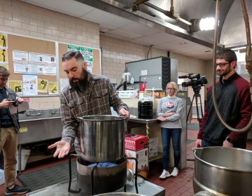 Brad Moyer goes over the beginning steps of home brewing during a class at Shippensburg University. (Rachel McDevitt/WITF)