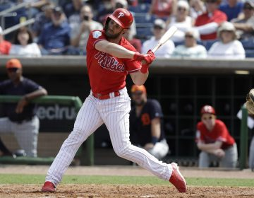 Philadelphia Phillies' Bryce Harper bats against the Detroit Tigers during the seventh inning of a spring training baseball game Wednesday, March 20, 2019, in Clearwater, Fla. (AP Photo/Chris O'Meara)